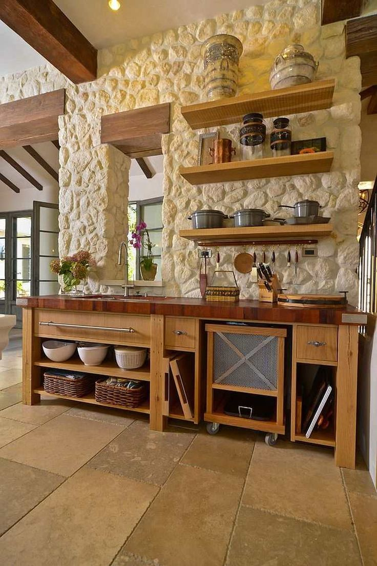 cucine in muratura rustiche e idee per la decorazione della parete in pietra