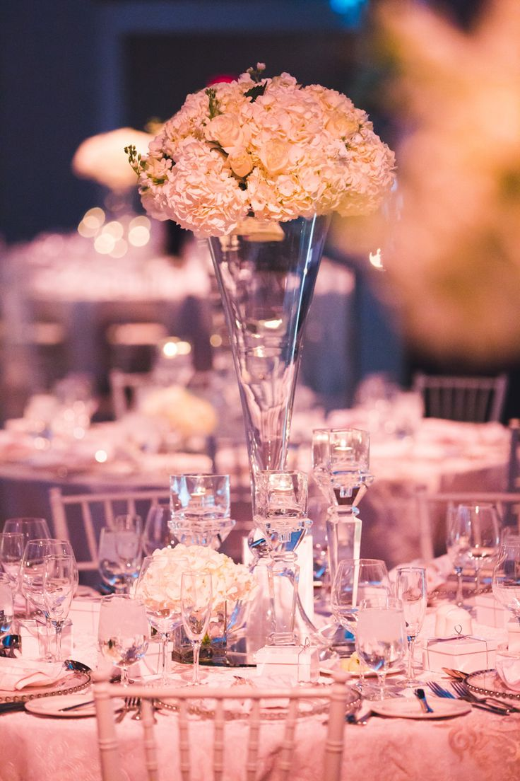 Centrepiece - Tall glass vase, Hydrangea floral arrangement http://www.fusion-events.ca/