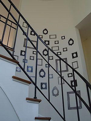 Frame wall decals and stickers in a stairwell designed by Vanessa de Vargas