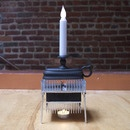 What do you make for the person who has everything (except perhaps a sense of irony)? How about a Candle-Powered Electric Candle?