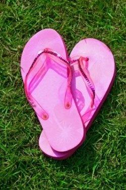 Pink flip flops - open shoes on the green grass.    Image credit: James Barker, FreeDigitalPhotos.net