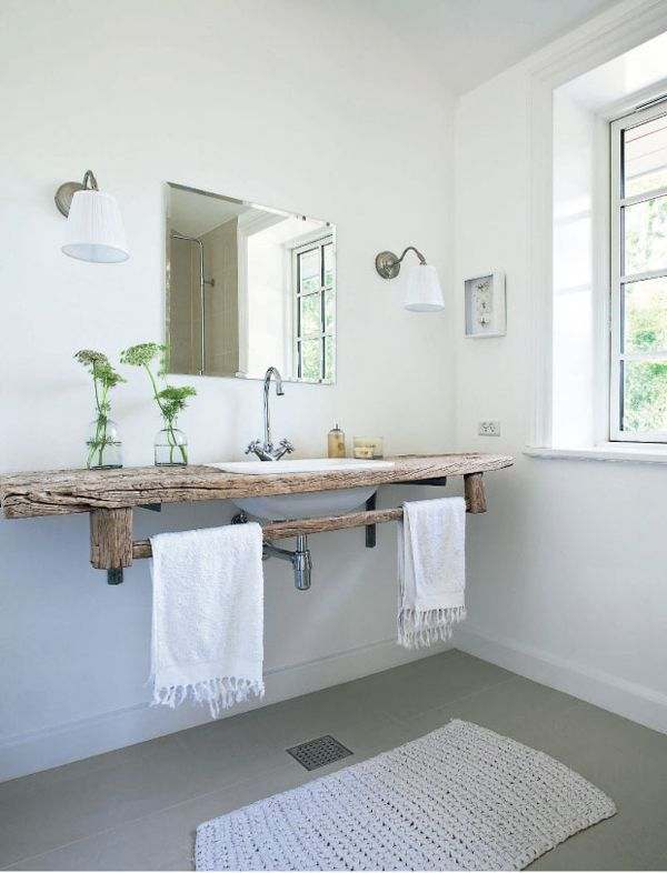 Get creative when introducing texture into your bathroom. Why not add a beautiful piece of wood to your space?