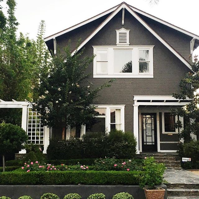 I've been digging dark exteriors lately and this cute little beach house (and awesome yard) we drove by has me all  #studiomcgeeneighbors