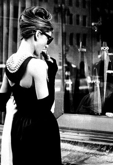 Audry Hepburn having her breakfast @ Tiffany's. When I was a teenage girl & first saw the movie, I knew I had found my style icon.
