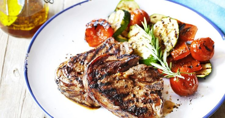 Feed the family fast with this classic dish of rosemary and garlic lamb chops served with grilled vegetables.
