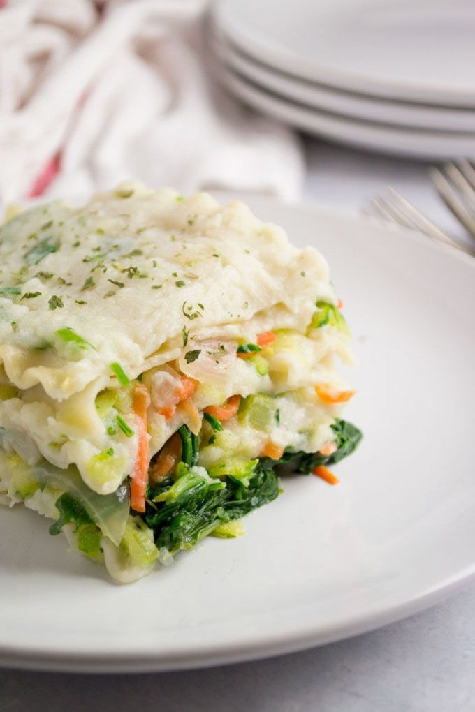 This vegan white lasagna has a luscious cauliflower sauce with veggie packed goodness!