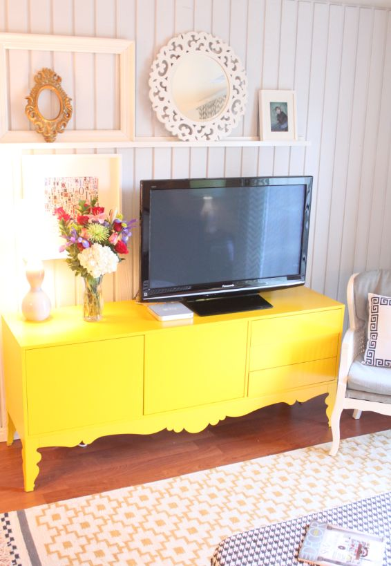 with paint you could turn a old wood tv unit into a bright modern tv stand accent piece that looks like its from ikea