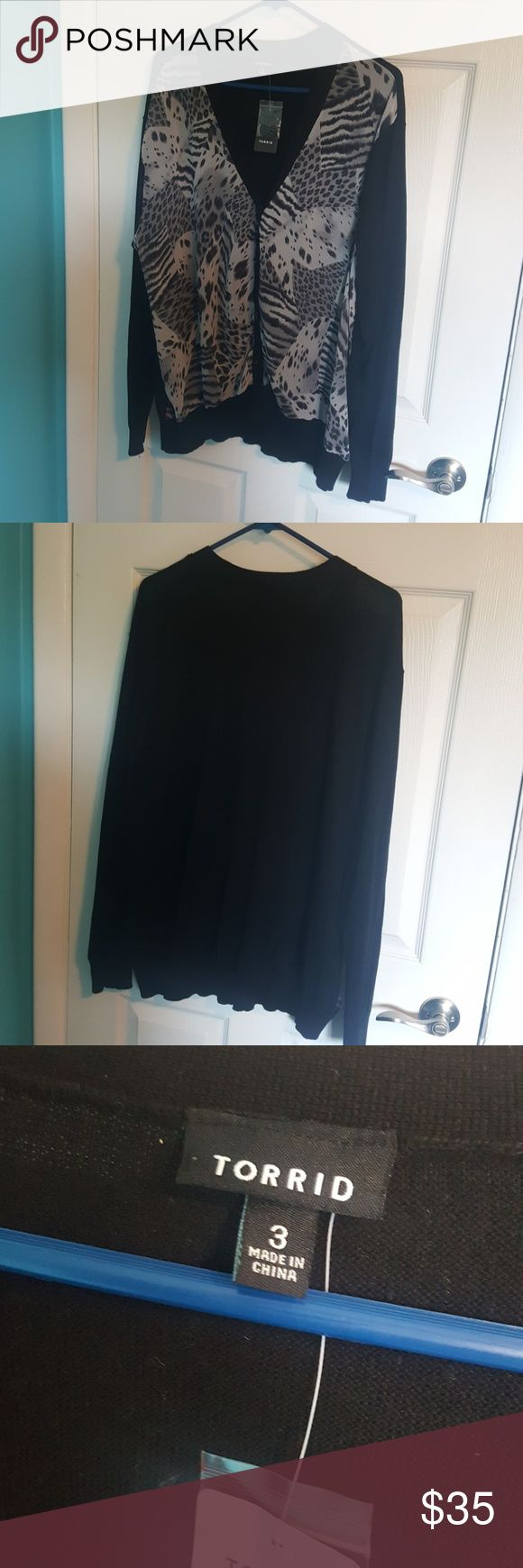 3 Torrid Animal Print Cardigan Never been worn. New with tags. Super cute animal print cardigan with black buttons and a solid black back. Coming from a smoke & pet free home. torrid Sweaters Cardigans
