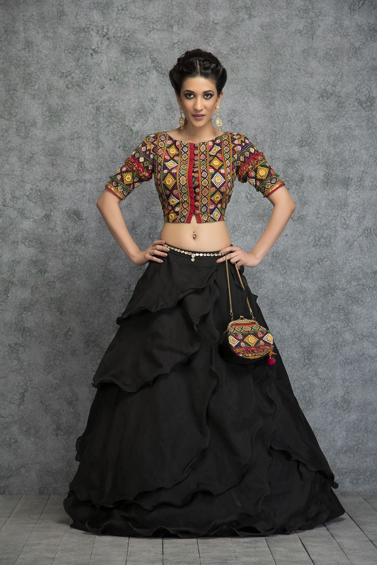 Add a dash of feminine mystique and swirl to your sangeet in this black beauty skirt teamed with multi colored crop top. A perfect choice for a sangeet or cocktail function, this fusion ensemble has chanderi black beauty layered skirt and kutch inspired fully embroidered crepe crop top with a touch of embroidery. A true blend of classic heritage with contemporary styling. - See more at: https://www.vemanya.com