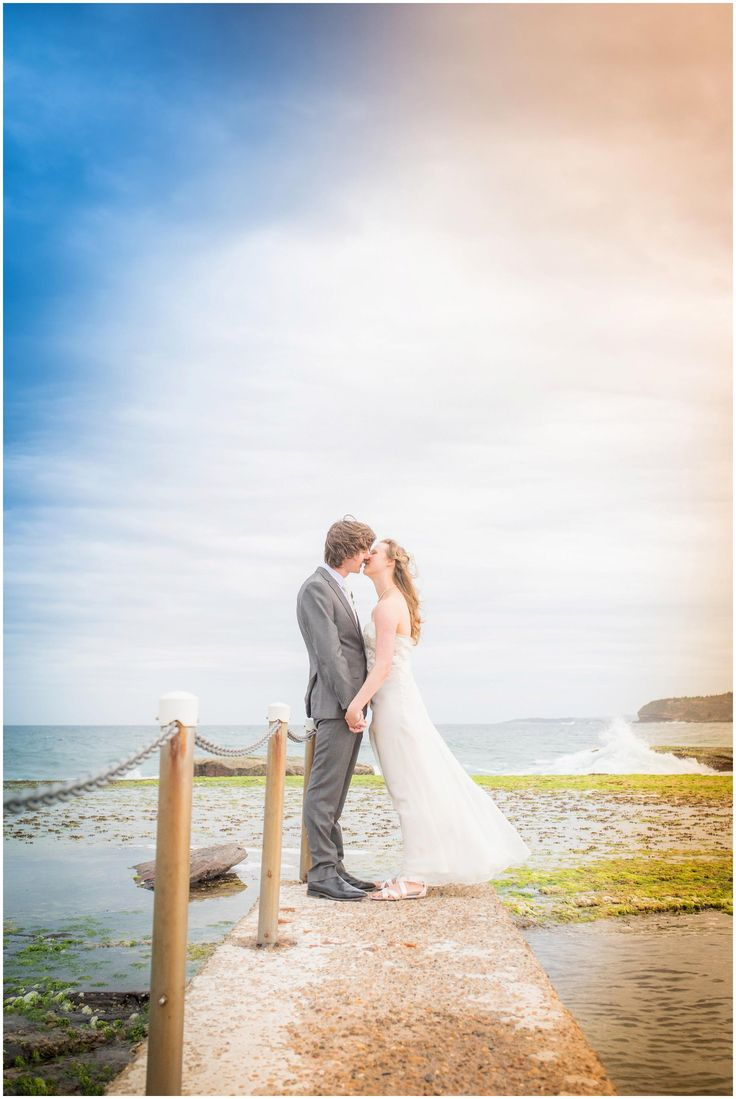 Romantic Mona Vale Wedding Photography on the rocks by the swimming pool.