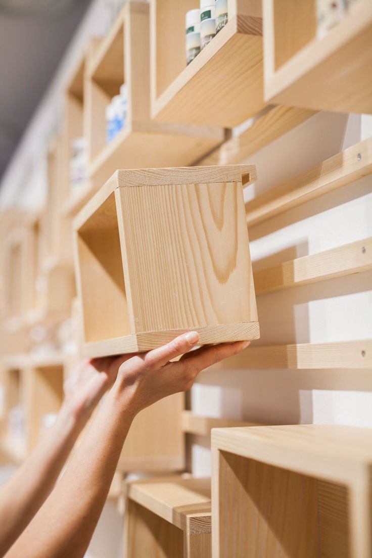 This wooden shelf design is from a retail cosmetics store.