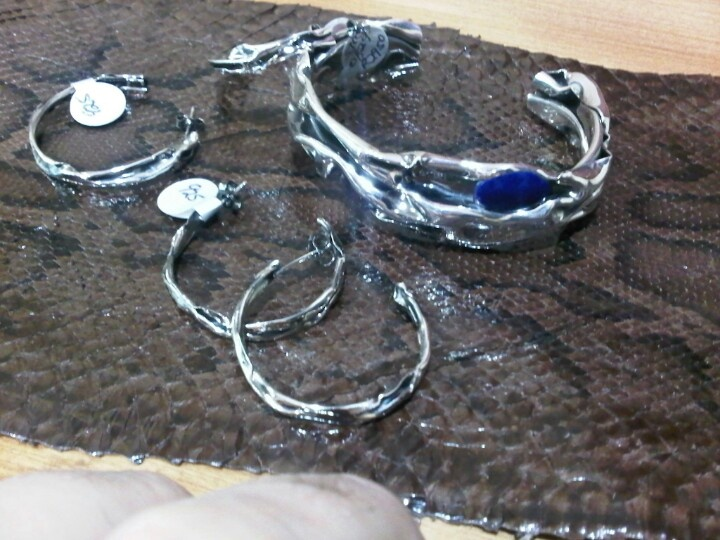 Sterling Silver Bracelet set with a Lapiz Lazully, and two pairs of Sterling Silver Earrings.