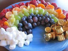 St. Patrick's Day Fun! Fruity Rainbow Snack - A fruity rainbow complete with marshmallow clouds and chocolate treasure!