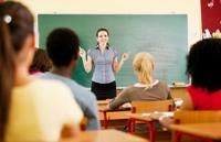 A teacher talks to a class of teens.