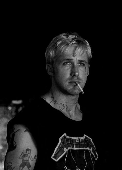 Ryan Gosling in The Place Beyond The Pines. Tatted & bleached hair...as if it were possible for him to be even more of a heart throb.