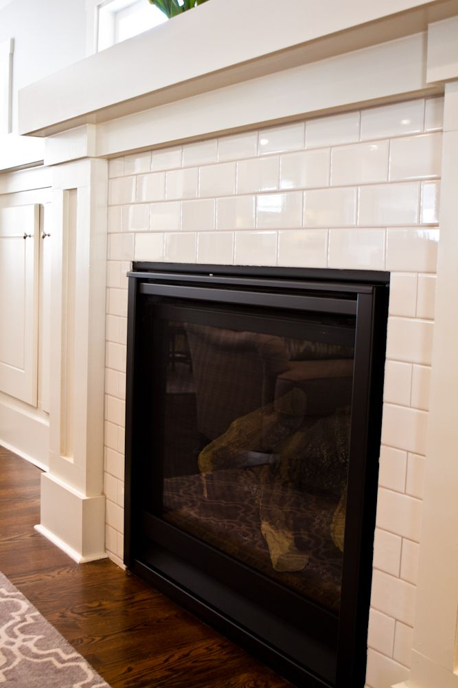Mulligan on 6 Subway tile Fireplace. I love the wood trim. Maybe a snazzier tile, but this is nice too.  I like what I can see of the rug.