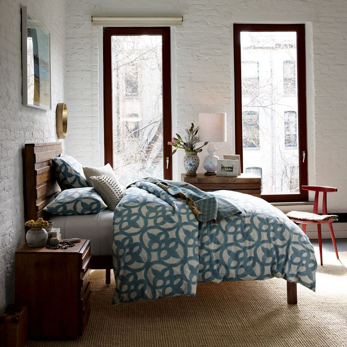 a modern geometric duvet can be transformed with a few odd eclectic pieces that have no real connection