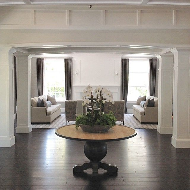 Peering into this elegant living room #clienthome #openconcept #livingspace #whitewalls #millwork #customdesign #bwd #interior