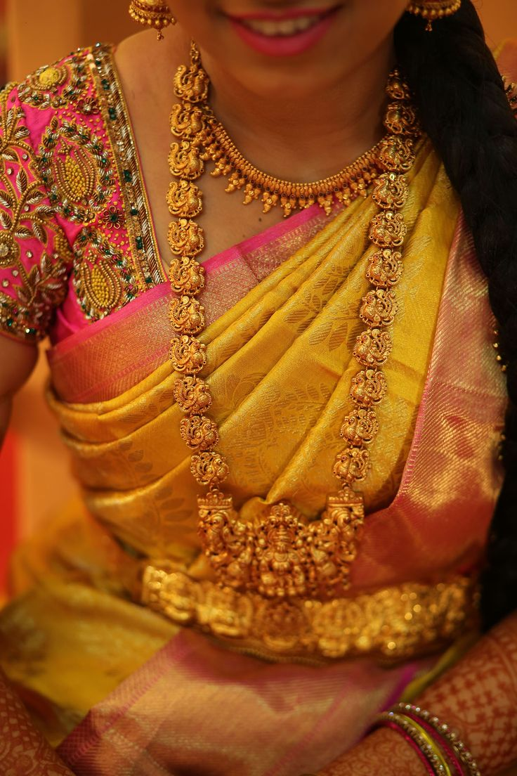 South Indian bride. Gold Indian bridal jewelry.Temple jewelry. Jhumkis. Mustard yellow and pink silk kanchipuram sari.Braid with fresh jasmine flowers. Tamil bride. Telugu bride. Kannada bride. Hindu bride. Malayalee bride.Kerala bride.South Indian wedding.