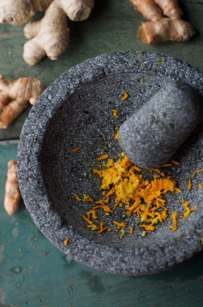Informative post on the health benefits of turmeric & ginger root & Making Golden Milk: Fresh Turmeric and Ginger with Mortar and Pestle