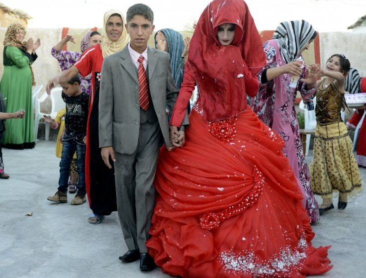 A traditional Iraqi bride might set the record for most wardrobe changes. Each of her seven dresses is a different color of the rainbow. Red represents love and romance.