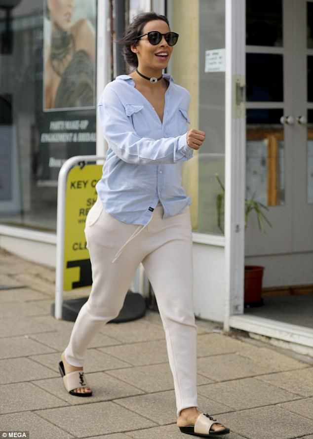 Stunning star: The former The Saturdays singer, 28, looked radiant in a casual light blue ...