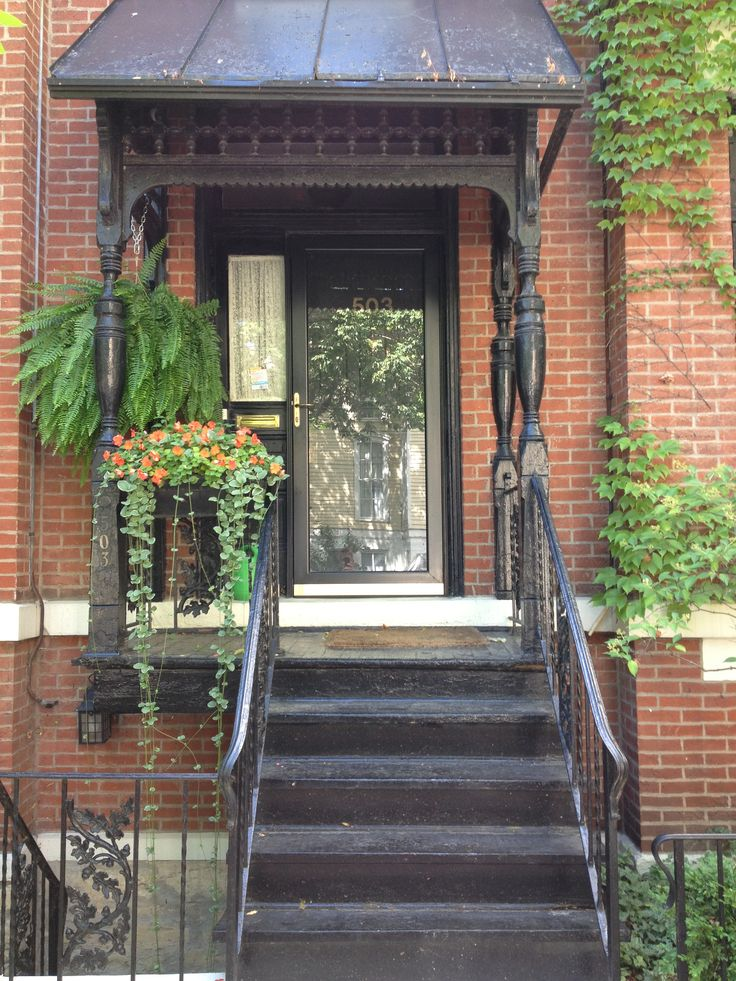 Front porch hanging plants row house north old town for Front porch hanging plants