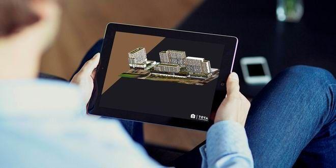 """Gayrimenkul sektörünün öncü markalarından Toya Yapı, yeni yazılım teknolojisi """"Artırılmış Gerçeklik"""" ile tablet ve akıllı telefonlar aracılığıyla """"Toya Moda""""nın tüm detaylarını proje hakkında bilgi almak isteyenlerin gözü önüne getiriyor."""