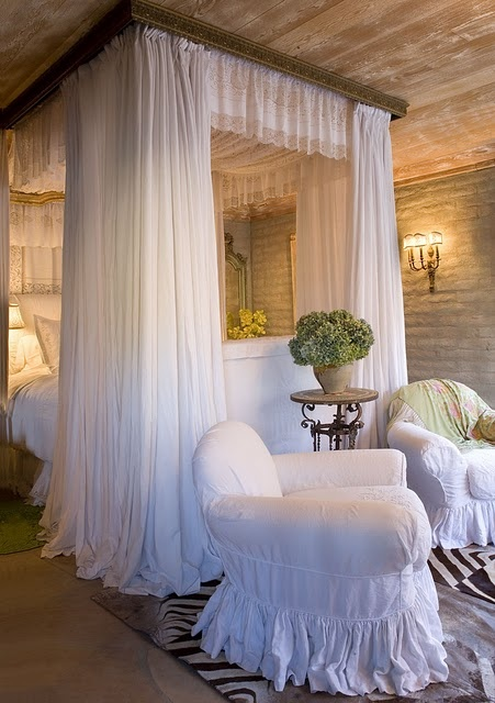 A little too princess for me, but love the idea of the trim around the ceiling and a fabric drop around the bed......