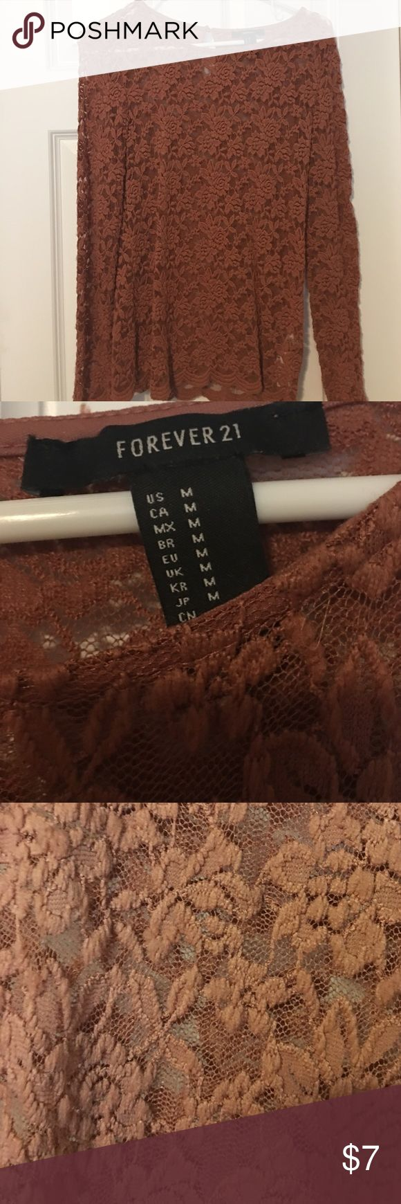 Sheer lace long sleeved top size M Pretty rust brown long sleeved sheer lace top from Forever 21. See thru and looks cute with a black tank underneath. No rips or jokes, great condition. Size medium. Forever 21 Tops