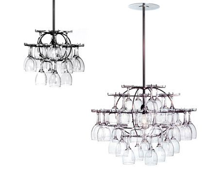 Upside-down wine glasses make up this chandelier. The stemware is meant to be used and then rehung. By selecting which glasses to hang, you design your own chandelier. Different kinds of glasses create different reflections and light patterns. If you choose all crystal glasses, it will look like a crystal chandelier.