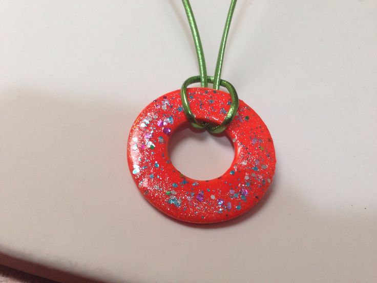 Washer necklace decorated with nail polish.