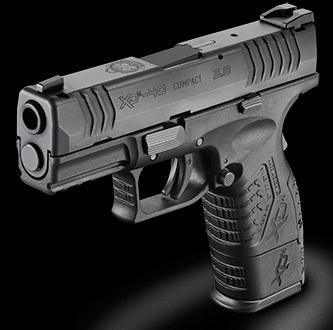 "Springfield XDM .40cal COMPACT 3.8"" barrel and shortened grip for conceal-ability."