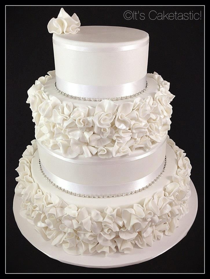 Gorgeous cake by It's Caketastic! I love how  every cake artist has a different version of ruffles...like handwriting, each of us unique.