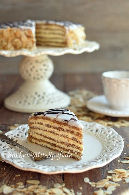 Hungarian Esterhazy cake - hazelnut meringue and vanila butter cream... yum!  - this recipe comes in English and other multiple language options.