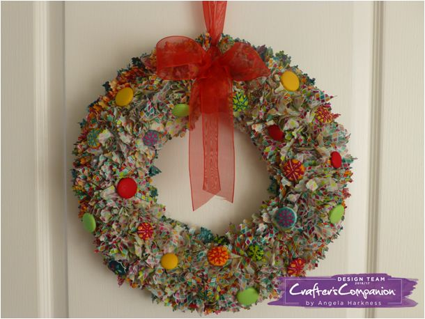 Christmas button wreath using Threaders fat quarters and Debbie Shore button factory. Designed by Angela Harkness #crafterscompanion