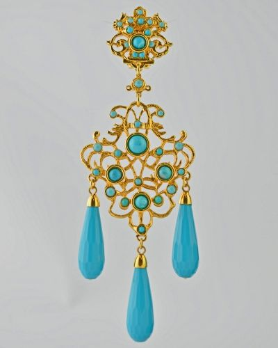 TURQUOISE SCROLL LRG.DROP 24 Karat gold plated scroll design drop earring with pale turquoise color faceted  tear drops in lucite , reconstituted turquoise cabachons and Austrian crystals . Earring is clip on . Earring is 4.5 inches long ans 1.3/4 inches at widest point. Get a 20% discount with promo code: Olusegun683. $390
