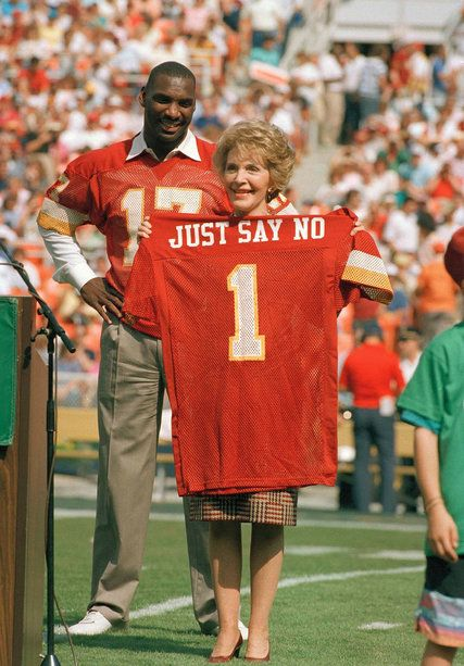 "Nancy Reagan with the Washington Redskins quarterback Doug Williams in 1988, holding a jersey with the slogan ""Just Say No."" Credit Doug Mills/Associated ..."