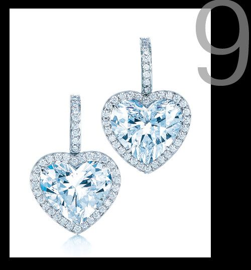 Each heart-shaped diamond in this pair of earrings is internally flawless and it took Tiffany & Co. more than a year to find two diamonds of equally exceptional quality. They are surrounded by 76 round diamonds, set in platinum and weigh 10.03 carats. www.tiffany.com  Window shopping is such fun.