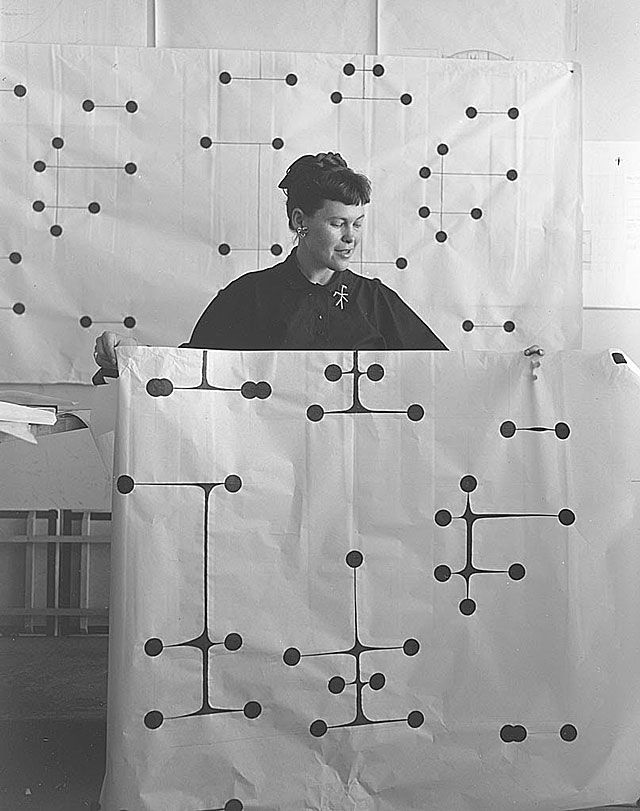 Ray Eames holding Dot Pattern Fabric Design, circa 1947.