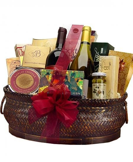 Deluxe Wine and Gourmet Basket  Two bottles of select wines from award winning vineyards are the focus of this basket. Add your personal touch in this basket by selecting a wine option of two reds two whites one bottle of each or one bottle of champagne.  $138.95