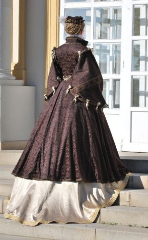 Anna of Austria - Galerilla  The resource for this Spanish court clothing is queen Anna`s portrait by Anthonis Mor made in 1570. The pattern of brown galerilla is based on R. Burgen drawing, the round sleeves are inspired by J.Alcga. The shape of decorative ribbon on the sleeve outer side are based on the decoration of Marketa Frantiska Lobkovicz cloak.    Part of the clothing is small hat and golden hairnet. Under galerilla is golden sateen doublet and golden skirt.