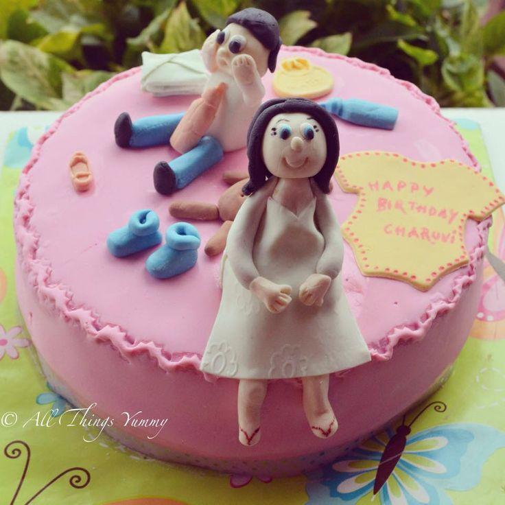Birthday Cakes for Girls - Pink Fondant Birthday Cake for a Mom to be with Fondant Bibs | All Things Yummy #mommytobe #mom #baby #onesie #booties #pacifier #bottle #nappypins #diaper #pregnantwoman #pregnant #babybump #bib #teddy #teddybear #softtoy #husband #wife #daddy #babyshower #fondantcake #customisedcake #atyummy #chocolatecake #shoes #babystuff