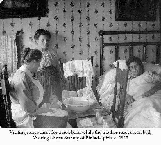 Visiting nurse cares for a newborn while the mother recovers in bed, Visiting Nurse Society of Philadelphia, c. 1910. Image courtesy of the Barbara Bates Center for the Study of the History of Nursing.