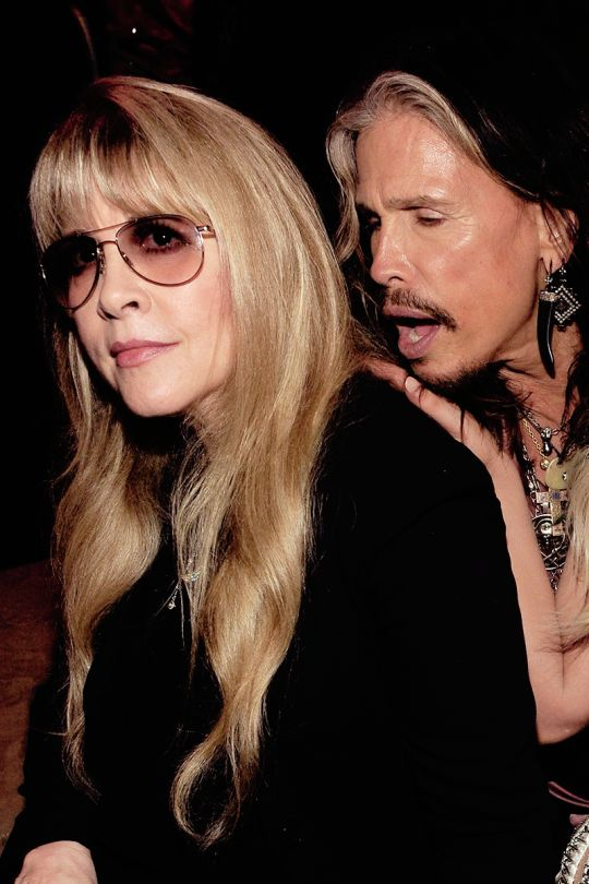 Stevie ~ ☆♥❤♥☆ ~  and Steven Tyler at the Vanity Fair Oscar Party in 2014; he looks like he's about to bite her neck :)