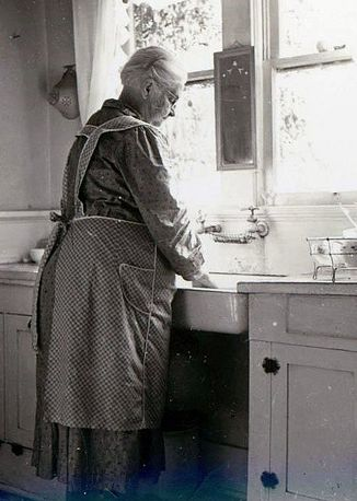 Wearing an apron to protect your limited wardrobe.  Apron's had multi-purposes.....