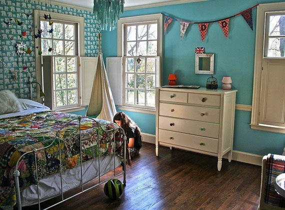 """precious robin egg blue, bird mobile above the bed, random dresser knobs, a real girl in the photo, but is her name really """"KIDDO""""?"""