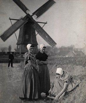 Historical costumes  from Walcheren & windmill, Zeeland, the Netherlands