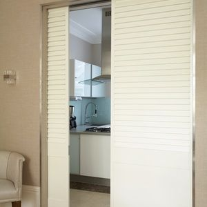 TNESC Full Height painted Shutters on sliding tracks with fixed blades