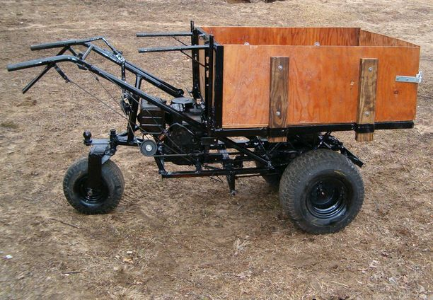 Powered Wheelbarrow by Ken Klos -- Homemade powered wheelbarrow constructed from surplus tubing, a gasoline engine, lawn tractor transmission, wheels, and plywood. http://www.homemadetools.net/homemade-powered-wheelbarrow